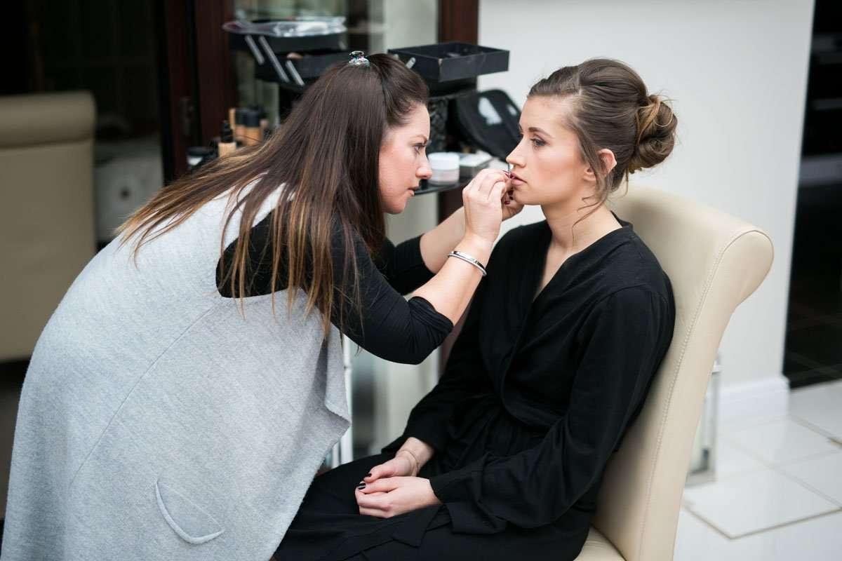 bridesmaid having her makeup done
