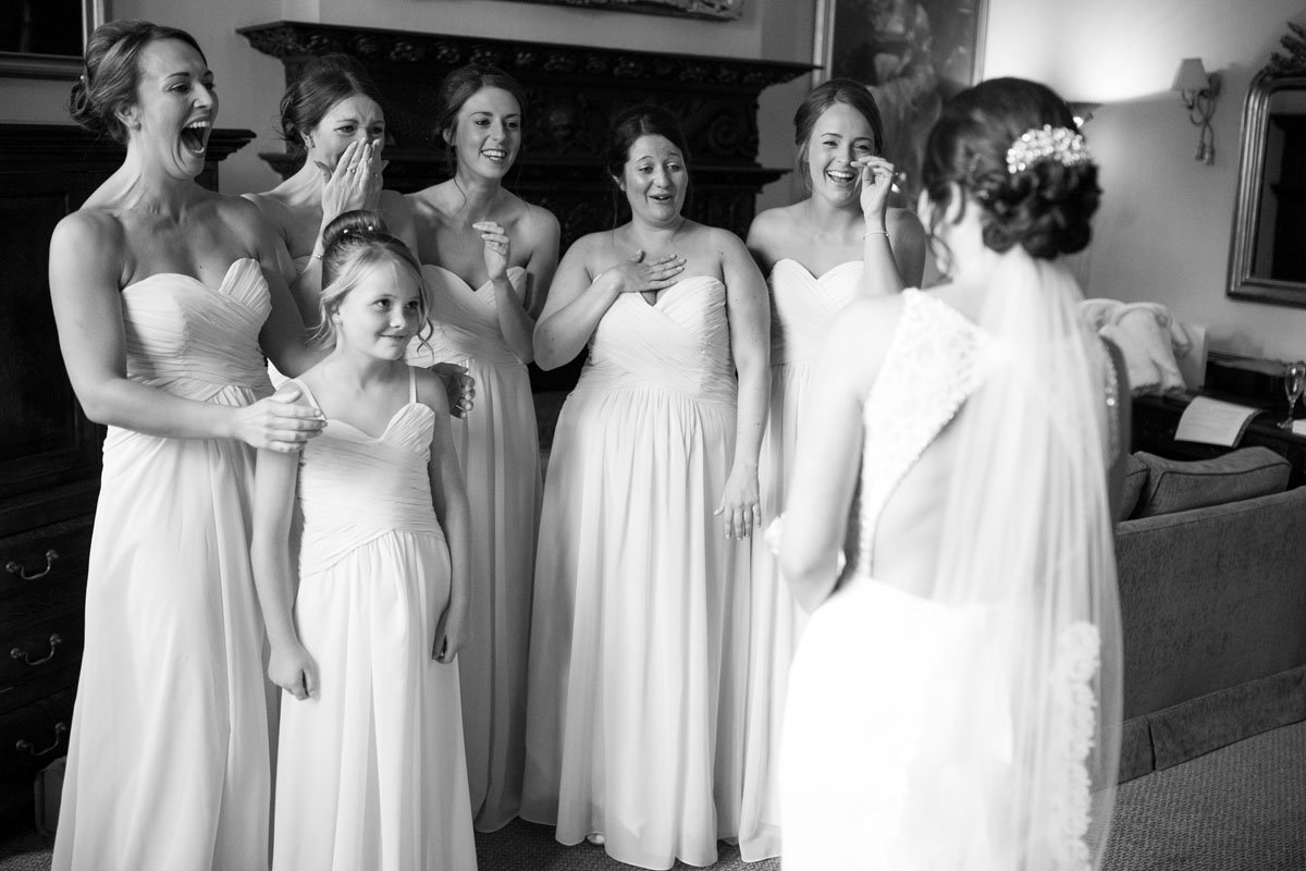 Bridesmaids smiling and laughing hystercially together
