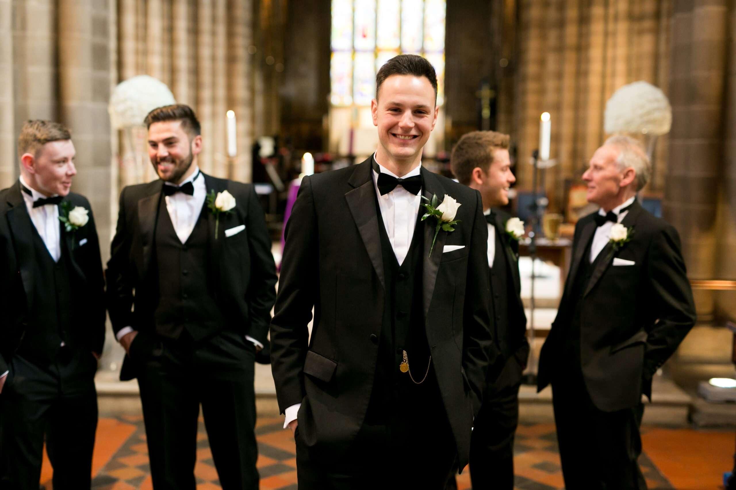 groomsmen posing at the midlands church