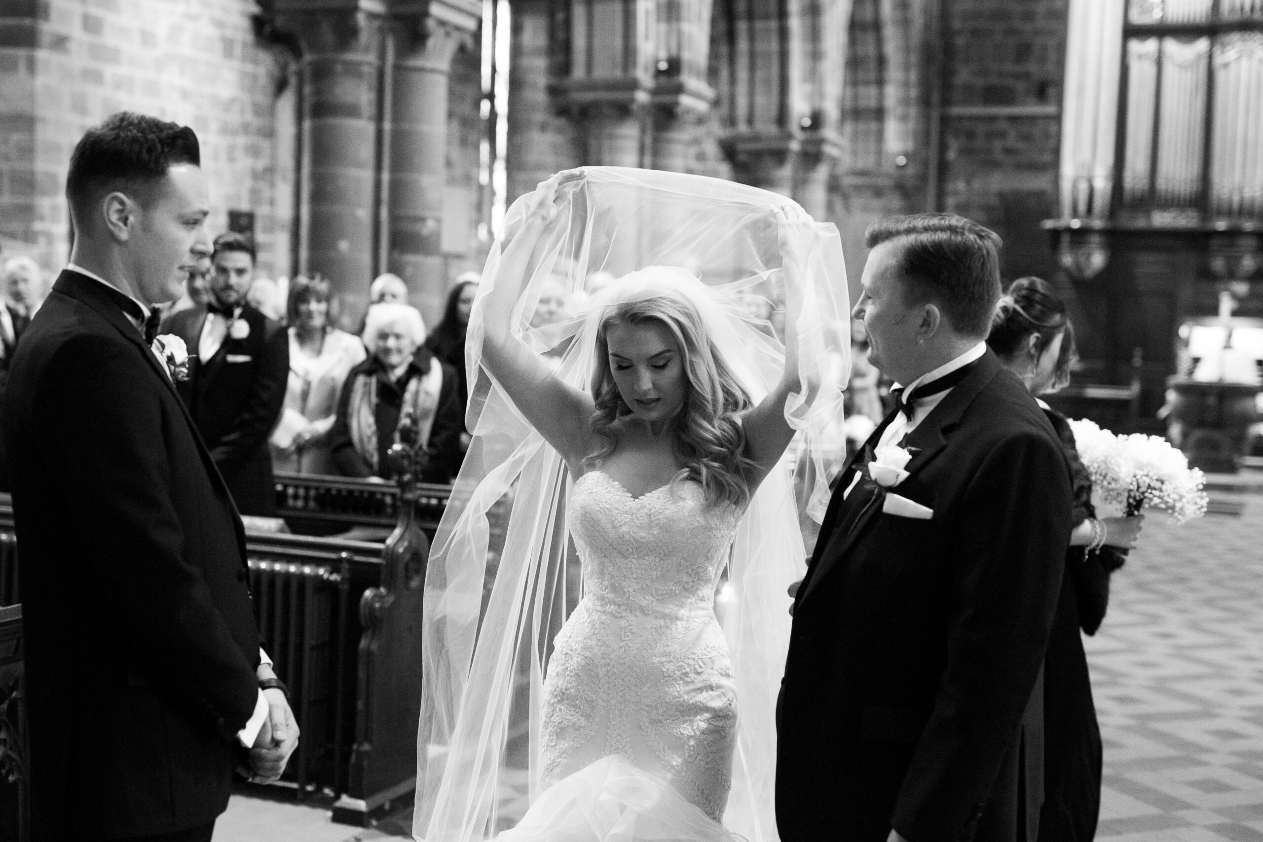 bride revealing her face from her veil