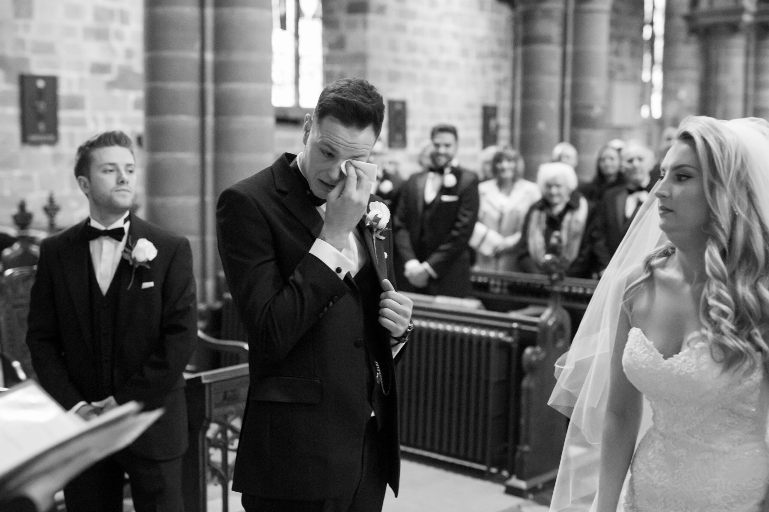 groom crying at the alter in a church in staffordshire
