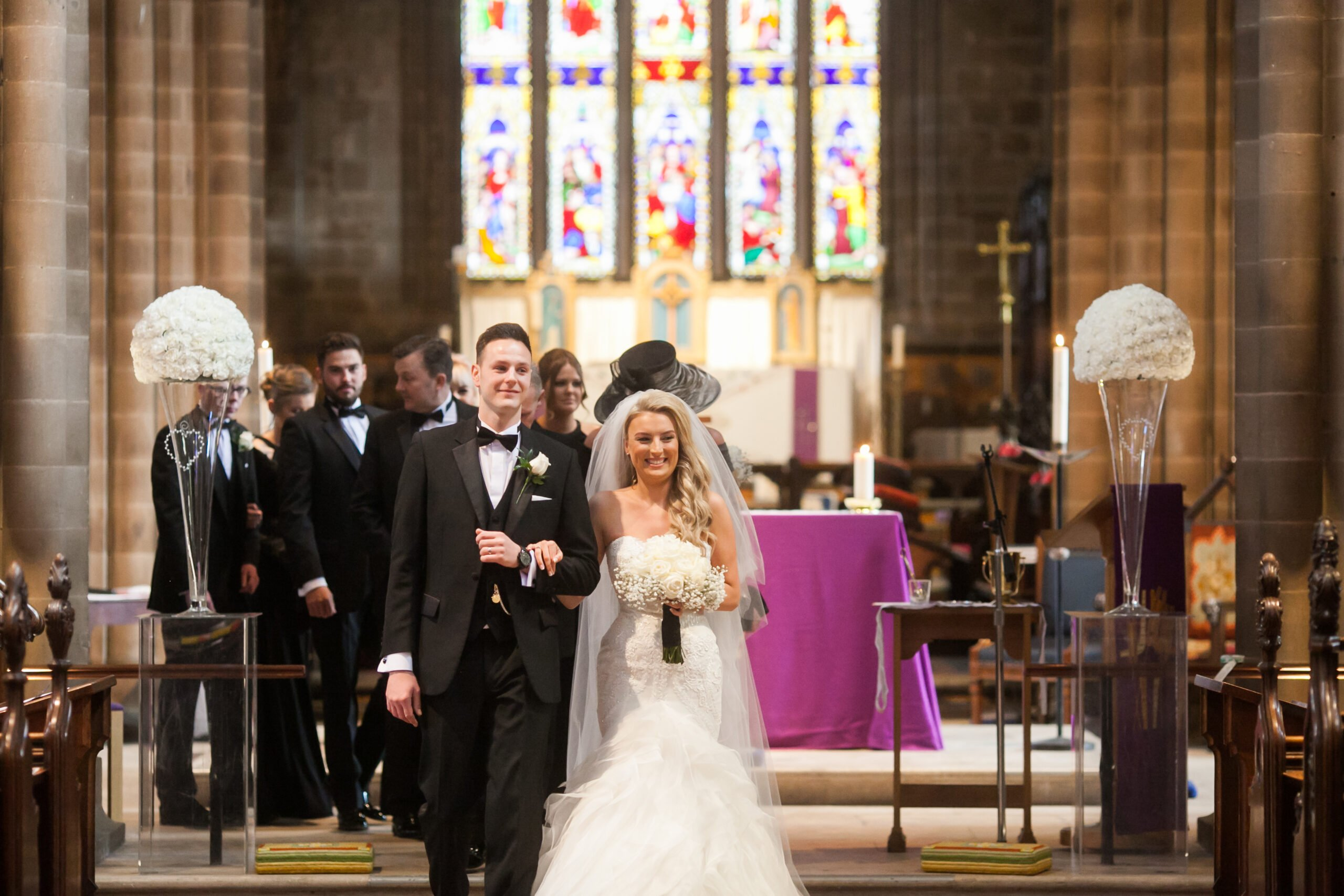 couple walking back down the aisle in the church