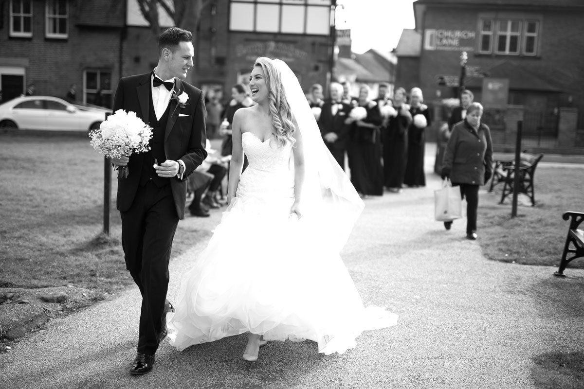 Couple walking down the path outside the church