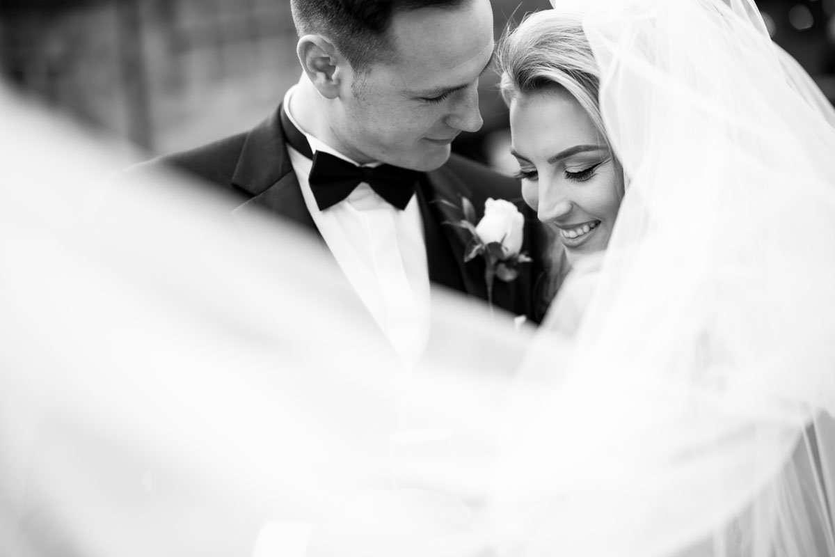 Veil shot straight through to the couple